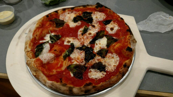 The first Tacconnelli pizza made in the new ovens at Mercer