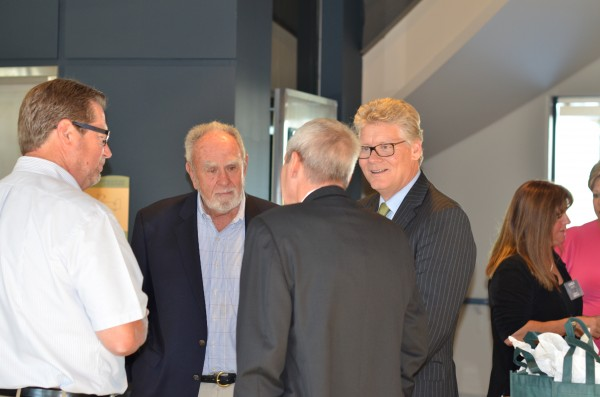 H&K Group, Inc.'s Founder and Co-Chairman of The Board, John B. Haines IV (center) engages in conversation with several clients and customers.