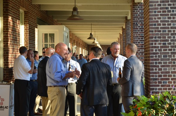 H&K Group, Inc. President and CEO, Scott B. Haines (second from right) engages several clients on the west-facing porch of Building 101, Suite 201.