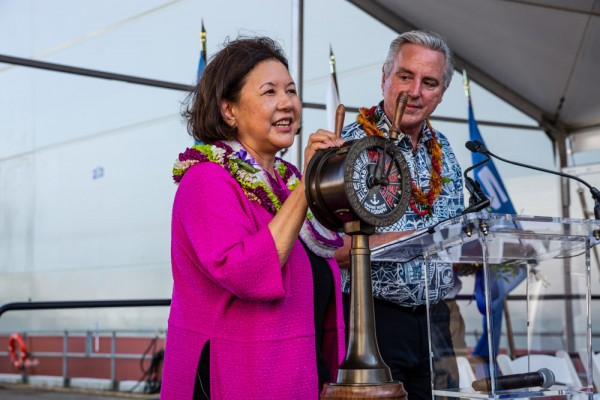 Ship sponsor, Irene Hirano Inouye, Senator Inouye's wife, christens the vessel by breaking a ceremonial bottle of champagne against the ship's hull. (Photo: Business Wire)